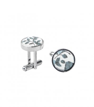 White cufflinks with blue-gray flowers