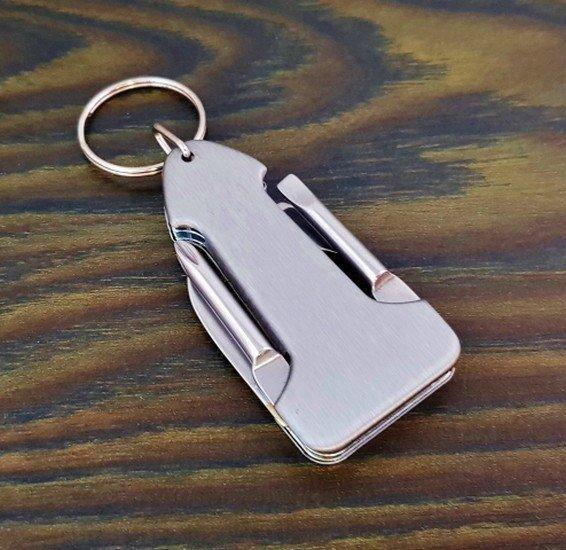 Praktikus kulcstartó - kés, nyitó, csavarhúzó